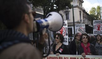 """State hospital workers chant slogans as they hold placards which read in Greek. """"Money for hospitals"""" during a protest in central Athens, on Wednesday, Nov. 14, 2018. Civil servants in Greece have walked off the job in a 24-hour strike to protest austerity measures and are demanding wage and pension increases as well as the abolition of all legislation imposed as part of the country's international bailouts. (AP Photo/Petros Giannakouris)"""