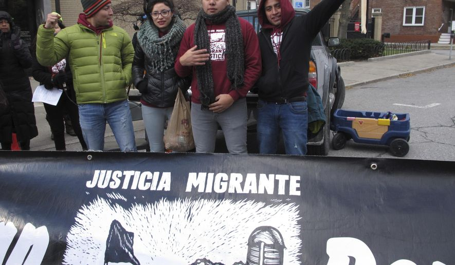 Members of the advocacy group migrant justice stand before for Vermont department of motor vehicles south burlington vt