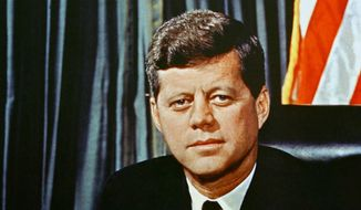 """FILE--This is a 1963 portrait of U.S President John F. Kennedy. John F. Kennedy is """"tweeting"""" from the grave in a new """"Words Count"""" campaign launched by the JFK Library Foundation which says it is intended to inform and inspire. Some see it as a subtle swipe at President Donald Trump's more bombastic use of the medium. (AP Photo/ File)"""