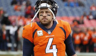 FILE - In this Nov. 4, 2018, file photo, Denver Broncos quarterback Case Keenum (4) warms up prior to an NFL football game against the Houston Texans in Denver. The Broncos quarterback is off to a rocky start in the shadows of John Elway, Peyton Manning and the Rocky Mountains. (AP Photo/Jack Dempsey, File)