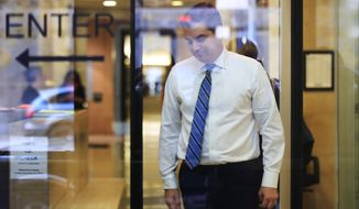 "CNN's Jim Acosta goes through security check as he enters the federal court in Washington, Wednesday, Nov. 14, 2018, to attend a hearing in a legal challenge against President Donal Trump's administration. Trump's administration contends it has ""broad discretion"" to regulate press access to the White House as it fends off a legal challenge from CNN and other outlets over the revocation of journalist Acosta's ""hard pass."" (AP Photo/Manuel Balce Ceneta)"