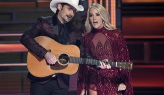 Brad Paisley, left, and Carrie Underwood during the opening of the 51st annual CMA Awards in Nashville, Tennessee, Nov. 8, 2017. (Photo by Chris Pizzello/Invision/AP, File)