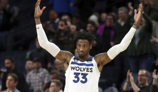 Newly acquired Minnesota Timberwolves' Robert Covington encourages the crowd in the final moments of an NBA basketball game against the New Orleans Pelicans Wednesday, Nov. 14, 2018, in Minneapolis. The Timberwolves won 107-100. (AP Photo/Jim Mone)
