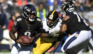 FILE - In this Nov. 4, 2018, file photo ,Baltimore Ravens quarterback Lamar Jackson (8) rushes the ball in the first half of an NFL football game against the Pittsburgh Steelers in Baltimore. Joe Flacco's hip injury means extra practice time for Ravens backup quarterbacks Lamar Jackson and Robert Griffin III, and perhaps one of them will make their first start of the season.  (AP Photo/Nick Wass, File)