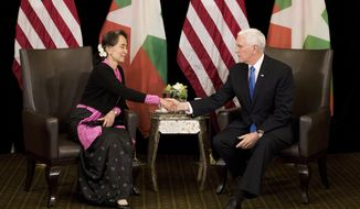 U.S. Vice President Mike Pence, right, meets Myanmar leader Aung San Suu Kyi in Singapore, Wednesday, Nov. 14, 2018. Pence is Singapore to attend the 33rd ASEAN summit. (AP Photo/Bernat Armangue, Pool)