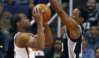 Phoenix Suns forward TJ Warren shoots over the San Antonio Spurs guard DeMar DeRozan, right, during the first half of an NBA basketball game, Wednesday, Nov. 14, 2018, in Phoenix. (AP Photo/Matt York)