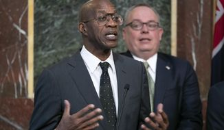 FILE - In this Wednesday, Oct. 31, 2018, file photo, Edwin Moses, chairman of the U.S. Anti-Doping Agency, speaks at a news conference during a White House event aimed at reforming the World Anti-Doping Agency, in Washington. Moses sent a tersely worded letter to leaders of the World Anti-Doping Agency, asking for an investigation into the culture at WADA that would expand beyond athletes' representative Beckie Scott's claim that she was bullied at a recent meeting. (AP Photo/J. Scott Applewhite, File)