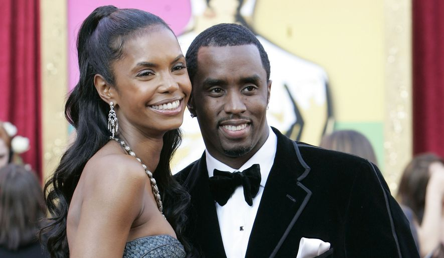 """Sean """"Diddy"""" Combs arrives with his girlfriend Kim Porter for the Academy Awards on Feb. 27, 2005, in Los Angeles. They became the parents of twin girls Thursday morning, Dec. 21, 2006, with the hip-hop impresario flying in from a movie set in Canada for the birth at a Manhattan hospital, said Combs spokesman Robert Zimmerman. (AP Photo/Amy Sancetta) ** FILE **"""