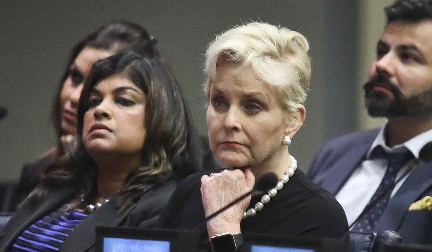 "Cindy McCain, second from right, co-chair of the McCain Institute's Human Trafficking Advisory Council, and trafficking survivor Rani Hong, second from left, listen after addressing the human rights conference, ""Stepping Up Action to End Forced Labour, Modern Slavery and Human Trafficking,"" during the United Nations General Assembly, Monday Sept. 24, 2018, at U.N. headquarters. (AP Photo/Bebeto Matthews) ** FILE **"