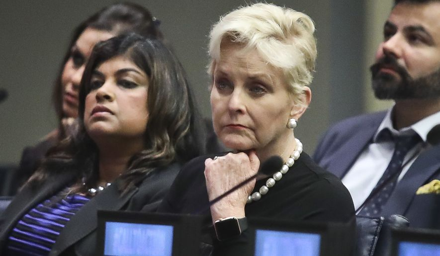 """Cindy McCain, second from right, co-chair of the McCain Institute's Human Trafficking Advisory Council, and trafficking survivor Rani Hong, second from left, listen after addressing the human rights conference, """"Stepping Up Action to End Forced Labour, Modern Slavery and Human Trafficking,"""" during the United Nations General Assembly, Monday Sept. 24, 2018 at U.N. headquarters. (AP Photo/Bebeto Matthews)"""