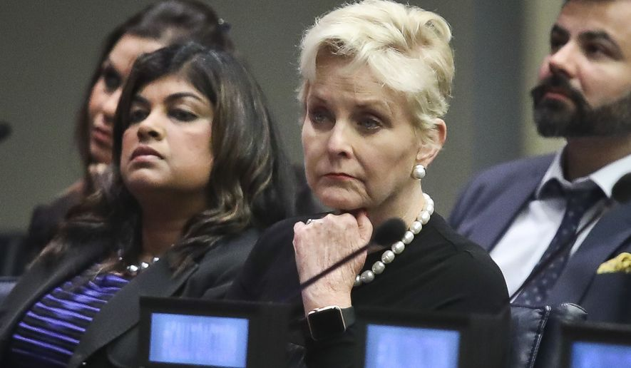 """Cindy McCain, second from right, co-chair of the McCain Institute's Human Trafficking Advisory Council, and trafficking survivor Rani Hong, second from left, listen after addressing the human rights conference, """"Stepping Up Action to End Forced Labour, Modern Slavery and Human Trafficking,"""" during the United Nations General Assembly, Monday Sept. 24, 2018, at U.N. headquarters. (AP Photo/Bebeto Matthews) ** FILE **"""