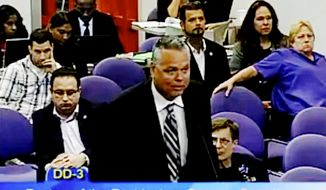 FILE - In this Feb. 18, 2015, file image from video from a Broward County Public Schools meeting school resource officer Scot Peterson  addresses the panel. Peterson is scheduled to testify Wednesday. Oct. 10, 2018, during the second day of this month's three-day hearing of the Marjory Stoneman Douglas High School Public Safety Commission. (Broward County Public Schools via AP, File)