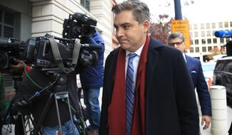 "CNN's Jim Acosta walks into federal court in Washington, Wednesday, Nov. 14, 2018, to attend a hearing on a legal challenge against President Donald Trump's administration. Trump's administration contends it has ""broad discretion"" to regulate press access to the White House as it fends off a legal challenge from CNN and other outlets over the revocation of Acosta's ""hard pass."" (AP Photo/Manuel Balce Ceneta)"