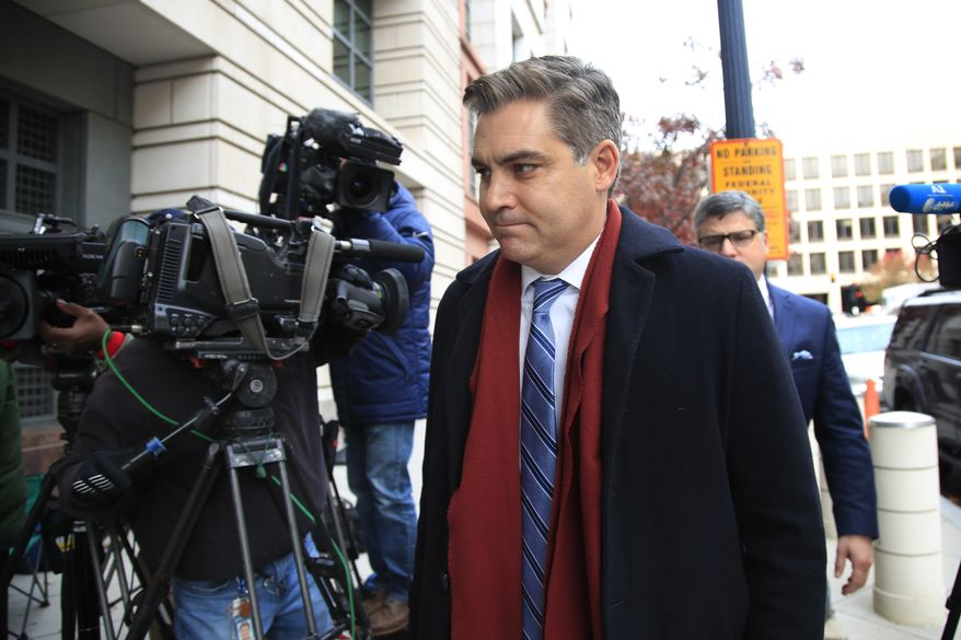 """CNN's Jim Acosta walks into federal court in Washington, Wednesday, Nov. 14, 2018, to attend a hearing on a legal challenge against President Donald Trump's administration. Trump's administration contends it has """"broad discretion"""" to regulate press access to the White House as it fends off a legal challenge from CNN and other outlets over the revocation of Acosta's """"hard pass."""" (AP Photo/Manuel Balce Ceneta)"""