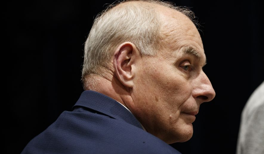 Then-White House Chief of Staff John Kelly looks on as President Donald Trump and first lady Melania Trump visit with Marines at Marine Barracks Washington, Thursday, Nov. 15, 2018, in Washington. (AP Photo/Evan Vucci) ** FILE **