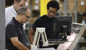 Employees at the Supervisor of Elections office run ballots through a machine during a recount, Thursday, Nov. 15, 2018, in West Palm Beach, Fla. (AP Photo/Wilfredo Lee)