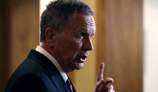 Ohio Gov. John Kasich, a potential 2020 Presidential candidate, gestures while addressing reporters in Concord, N.H., Thursday, Nov. 15, 2018. The visit marked Gov. Kasich's second trip to the state this year. (AP Photo/Charles Krupa)