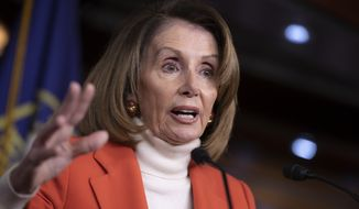 House Minority Leader Nancy Pelosi, D-Calif., faces reporters during a news conference at the Capitol in Washington, Thursday, Nov. 15, 2018. (AP Photo/J. Scott Applewhite)
