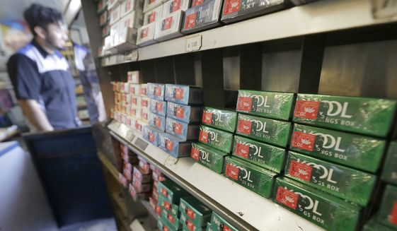 This May 17, 2018 file photo shows packs of menthol cigarettes and other tobacco products at a store in San Francisco.  (AP Photo/Jeff Chiu) **FILE**