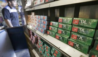 FILE - This May 17, 2018 file photo shows packs of menthol cigarettes and other tobacco products at a store in San Francisco. On Thursday, May 15, 2018, FDA Commissioner Dr. Scott Gottlieb pledged to ban menthol from cigarettes, in what could be a major step to further push down U.S. smoking rates. (AP Photo/Jeff Chiu)