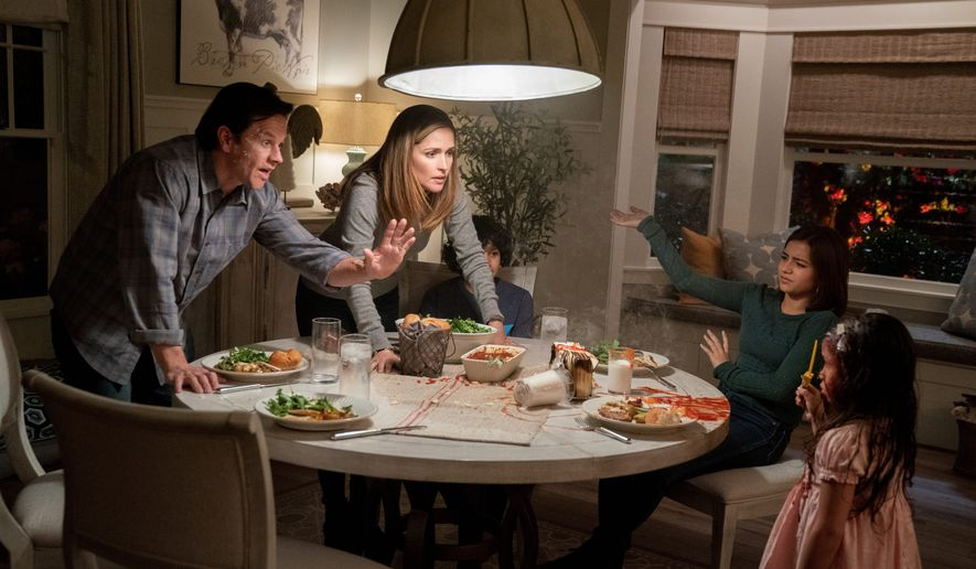"This image released by Paramount Pictures shows Mark Wahlberg, from left, Rose Byrne, Gustavo Quiroz, Isabela Moner, and Julianna Gamiz in a scene from ""Instant Family."" (Hopper Stone/Paramount Pictures via AP)"