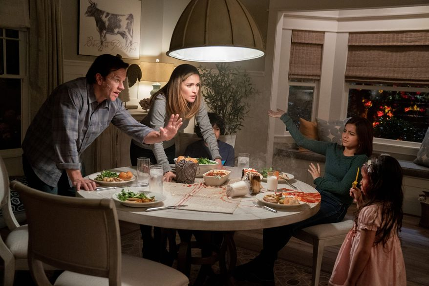 """This image released by Paramount Pictures shows Mark Wahlberg, from left, Rose Byrne, Gustavo Quiroz, Isabela Moner, and Julianna Gamiz in a scene from """"Instant Family."""" (Hopper Stone/Paramount Pictures via AP)"""