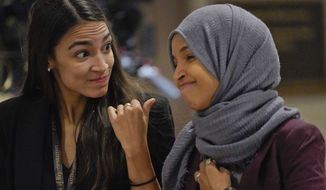 Rep.-elect Alexandria Ocasio-Cortez, D-NY., left, talks with Rep.-elect IIhan Omar, D-Minn., right, as they walk over to member-elect briefings on Capitol Hill in Washington, Thursday, Nov. 15, 2018. (AP Photo/Pablo Martinez Monsivais)