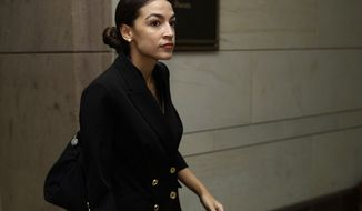 Rep.-elect Alexandria Ocasio-Cortez, D-N.Y., walks to member-elect briefings on Capitol Hill in Washington, Thursday, Nov. 15, 2018. (AP Photo/Carolyn Kaster)