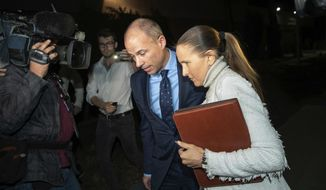 Michael Avenatti leaves the Los Angeles Police Department Pacific Division after posting bail for a felony domestic violence charge, Wednesday, Nov. 14, 2018. (AP Photo/Michael Owen Baker)