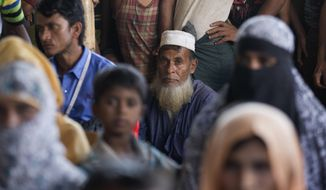 Rohingya refugees wait for news on the repatriation process at Unchiprang refugee camp near Cox's Bazar, in Bangladesh, Thursday, Nov. 15, 2018. The head of Bangladesh's refugee commission said plans to begin a voluntary repatriation of Rohingya Muslim refugees to their native Myanmar on Thursday were scrapped after officials were unable to find anyone who wanted to return. (AP Photo/Dar Yasin)