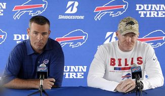 FILE - In this July 26, 2018 file photo Buffalo Bills general manager Brandon Beane, left, and coach Sean McDermott speak to the media at the NFL football team's training camp in Pittsford, N.Y. With little money to spend and few impact players interested in signing with the Bills given the uncertainty at quarterback this past offseason, Beane understood Buffalo's offense was going to endure its struggles. (AP Photo/Adrian Kraus, file)