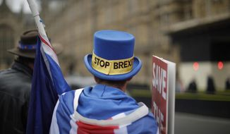Anti-Brexit supporter Steve Bray from south Wales, protests outside the Houses of Parliament in London, Thursday Nov. 15, 2018. Leading Brexiteer Jacob Rees-Mogg has submitted a letter of no confidence in Theresa May, as the Prime Minister reels from the loss of four ministers - including two from her Cabinet - in protest at her Brexit plans. (AP Photo/Matt Dunham)