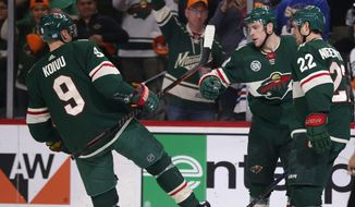 Minnesota Wild center Charlie Coyle (3) celebrates his goal with Mikko Koivu (9) and Nino Niederreiter (22) during the first period of an NHL hockey game against the Vancouver Canucks on Thursday, Nov. 15, 2018, in St. Paul, Minn. (AP Photo/Andy Clayton-King)