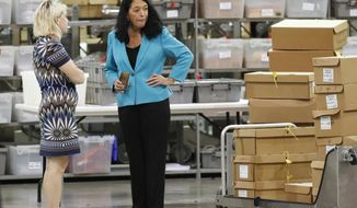 Palm Beach County Supervisor Of Elections Susan Bucher, right, talks to an employee at the Supervisor of Elections office during a recount, Thursday, Nov. 15, 2018, in West Palm Beach, Fla. (AP Photo/Wilfredo Lee)