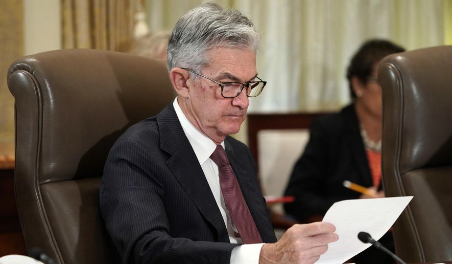 In this Oct. 31, 2018, file photo, Federal Reserve Chair Jerome Powell looks over papers as the Federal Reserve Board holds a meeting in Washington. The Federal Reserve says it will conduct a wide-ranging review next year of the strategies and tools it uses to achieve its congressionally mandated goals of maximum employment and price stability. The Fed says the review will also examine ways the Fed communicates with the public. (AP Photo/Jacquelyn Martin, File)