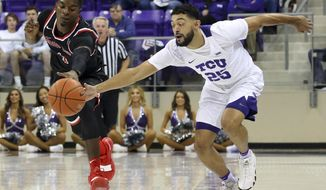 Fresno State guard Braxton Huggins (4) and TCU guard Alex Robinson (25) chase a loose ball during the first half of an NCAA college basketball game Thursday, Nov. 15, 2018, in Fort Worth, Texas. (AP Photo/Richard W. Rodriguez)