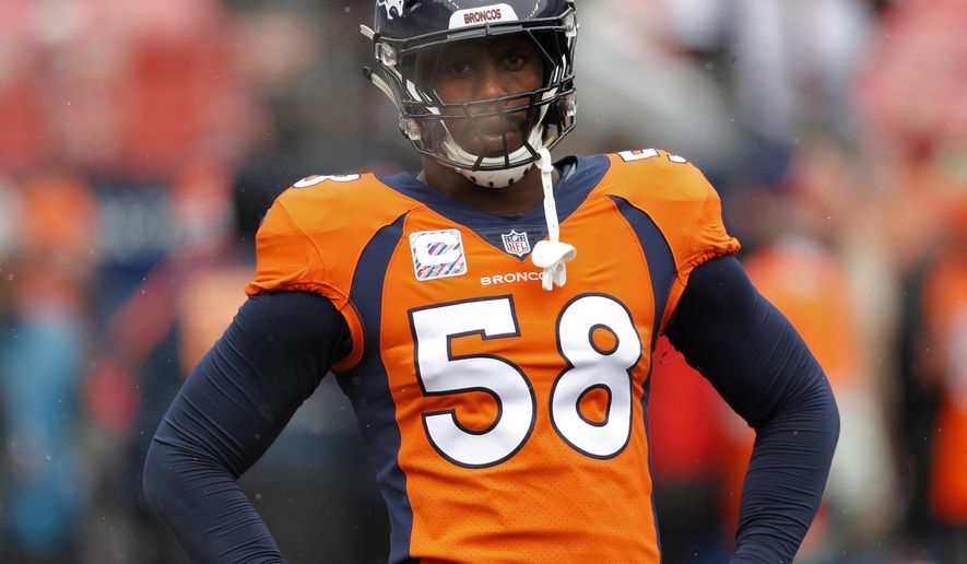 """FILE - In this Oct. 14, 2018, file photo, Denver Broncos linebacker Von Miller (58) warms up prior to an NFL football game against the Los Angeles Rams, in Denver. Try as he might, Von Miller just can't find anything bad to say about Philip Rivers anymore.  """"I've always enjoyed going against Philip,"""" Miller said Thursday, Nov. 15, 2018. (AP Photo/David Zalubowski, File)"""