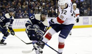 Florida Panthers forward Frank Vatrano, right, gets tangled up with Columbus Blue Jackets forward Brandon Dubinsky, center, during the first period of an NHL hockey game in Columbus, Ohio, Thursday, Nov. 15, 2018. (AP Photo/Paul Vernon)