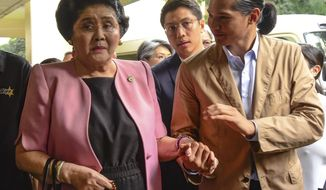 Former Philippine First Lady Imelda Marcos arrives at an anti-graft court Sandiganbayan to explain her side for not attending last week's promulgation of the graft charges against her Friday, Nov. 16, 2018 in suburban Quezon city northeast of Manila, Philippines. A Philippine court found Imelda Marcos guilty of graft and ordered her arrest last week in a rare conviction among many corruption cases that she's likely to appeal to avoid jail and losing her seat in Congress. (AP Photo/Maria S. Tan)