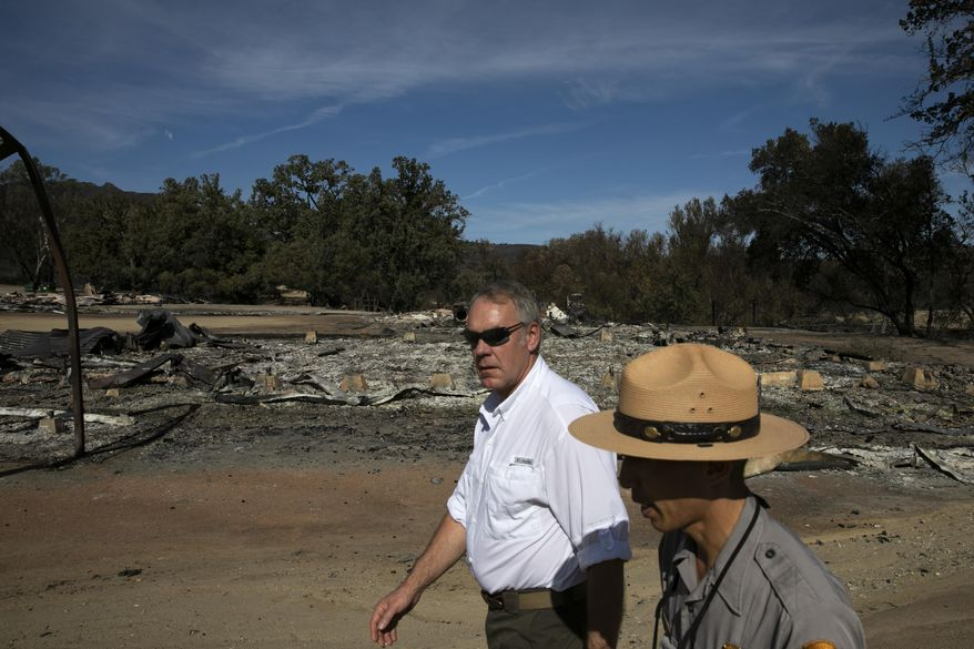 U.S. Secretary of the Interior Ryan Zinke, center, visits decimated Paramount Ranch Thursday, Nov. 15, 2018, in Agoura Hills, Calif. The landmark film location was burned to the ground by the Woolsey Fire. (AP Photo/Jae C. Hong)