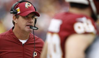 FILE - In this Oct. 14, 2018, file photo, Washington Redskins head coach Jay Gruden watches from the sidelines during the second half of an NFL football game against the Carolina Panthers in Landover, Md. Gruden occasionally has to remind people his team is in 6-3 and in first place. (AP Photo/Patrick Semansky, File)