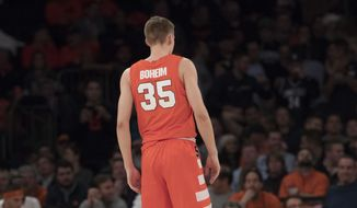 Syracuse guard Buddy Boeheim's name is misspelled on his jersey during the second half of an NCAA college basketball game against the Connecticut in the 2K Empire Classic, Thursday, Nov. 15, 2018, at Madison Square Garden in New York. Connecticut won 83-76. Buddy Boeheim is the son of Syracuse head coach Jim Boeheim. (AP Photo/Mary Altaffer) **FILE**