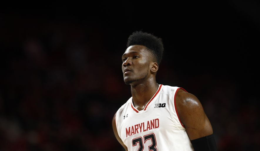 Maryland forward Bruno Fernando, of Angola, stands on the court in the second half of an NCAA college basketball game against Hofstra, Friday, Nov. 16, 2018, in College Park, Md. (AP Photo/Patrick Semansky) **FILE**