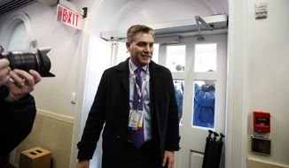 CNN journalist Jim Acosta arrives at the White House after having his press pass restored, Friday, Nov. 16, 2018, in Washington. (AP Photo/Manuel Balce Ceneta)