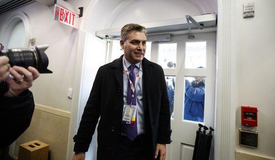CNN journalist Jim Acosta arrives at the White House after having his press pass restored, Friday, Nov. 16, 2018, in Washington. (AP Photo/Manuel Balce Ceneta)
