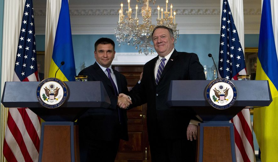Secretary of State Mike Pompeo shake hands with Ukrainian Foreign Minister Pavlo Klimkin after speaking to the media at the Department of State Friday, Nov. 16, 2018, in Washington. (AP Photo/Jose Luis Magana) **FILE**