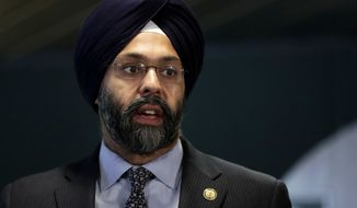 New Jersey attorney general Gurbir Grewal speaks during a news conference addressing a snowstorm that hit the northern New Jersey region a day earlier, Friday, Nov. 16, 2018, in Woodbridge, N.J. Gov. Phil Murphy is under fire because many commuters were stranded on highways during the snowstorm that hit during the rush hour traffic. (AP Photo/Julio Cortez)
