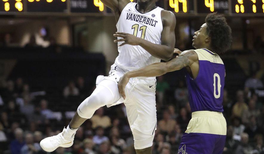 Vanderbilt forward Simisola Shittu (11) drives past Alcorn State guard Troymain Crosby (0) in the second half of an NCAA college basketball game Friday, Nov. 16, 2018, in Nashville, Tenn. Vanderbilt won 79-54. (AP Photo/Mark Humphrey)