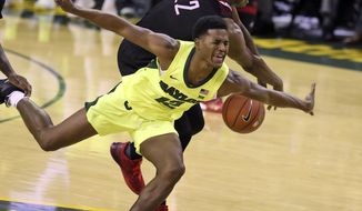 Baylor guard Jared Butler, front, vies for a loose ball with Nicholls State forward Brandon Moore Jr. during the first half of an NCAA college basketball game, Friday, Nov. 16, 2018, in Waco, Texas. (Rod Aydelotte/Waco Tribune-Herald via AP)