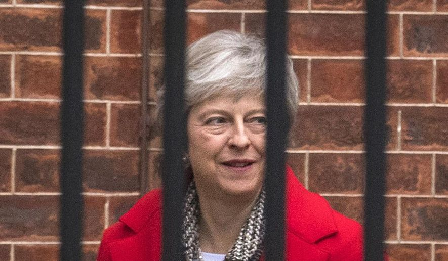 Britain's Prime Minister Theresa May leaves Downing Street in London, Friday, Nov. 16, 2018. May appealed directly to voters to back her Brexit plan Friday as she braced for a potential leadership challenge from rivals within her ruling Conservative Party. (Dominic Lipinski/PA via AP) ** FILE **